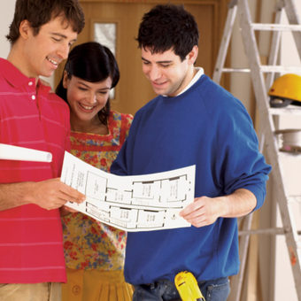 Couple Examining Remodeling Plans